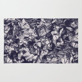 Indigo butterfly photograph duo tone blue and cream Rug