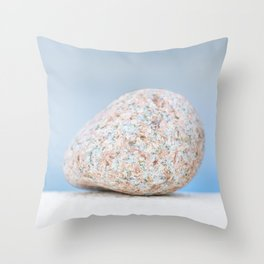 Granite pebble with blue water background Throw Pillow