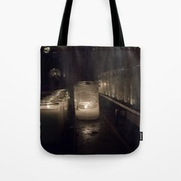Light a candle, Say a prayer. Tote Bag