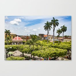 Red Gazebo and Trees Lining the Parque Colon de Granada in Nicaragua Canvas Print