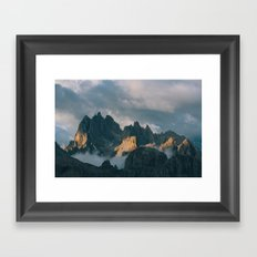 First light over jagged peaks Framed Art Print