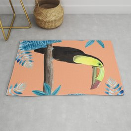Toucan with tropical leaves and a coral background Rug