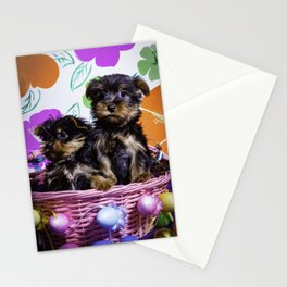 Two Yorkshire Terrier Puppies Sitting in a Pink Easter Basket in front of Spring Flower Background Stationery Cards
