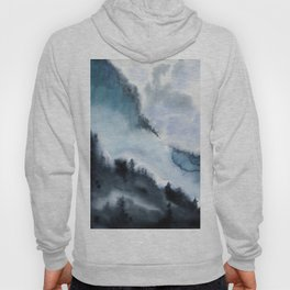 Watercolor landscape of a mountain with trees against a background of clouds, fog and storm clouds Hoody