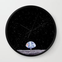 neil gaiman Wall Clocks featuring Neil Armstrong by Enrico Barin Guarise