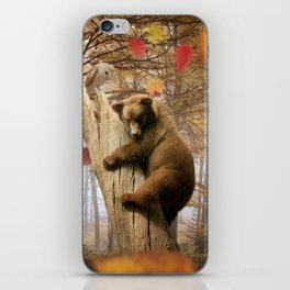 Brown bear climbing on tree iPhone Skin