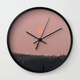 Neon Sun in Glacier National Park Wall Clock