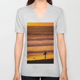 Surfer walking along beach at sunset Unisex V-Neck