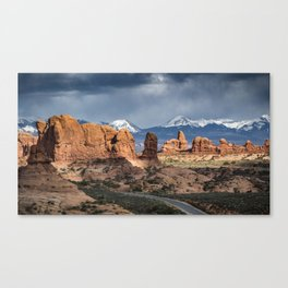 Storms over the La Sal Mountains and Turret Arch in Arches National Park, Utah Canvas Print