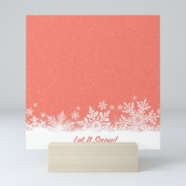 Let It Snow in Living_Coral Mini Art Print