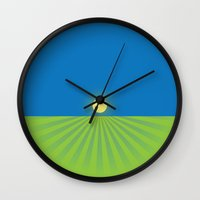 sun and moon Wall Clocks featuring Sun by Paco Dozier