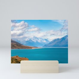 Blue waters of Lake Pukaki with snow-capped Mount Cook in the background in New Zealand Mini Art Print