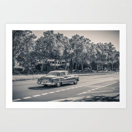 Old american car on the road Art Print