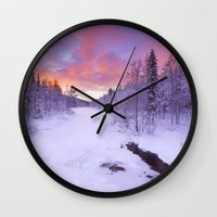 levi Wall Clocks featuring I - Sunrise over a river in winter near Levi, Finnish Lapland by Sara Winter