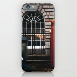 TIME LAPSE PHOTOGRAPHY OF WOMAN WALKING ON STREET WHILE HOLDING UMBRELLA NEAR LONDON TELEPHONE BOOTH BESIDE WALL iPhone Case