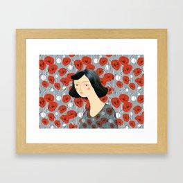 Girl on poppies Framed Art Print