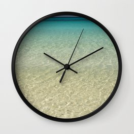 Crystal clear turquoise shaded waters of a sandy beach Wall Clock