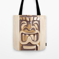 tiki Tote Bags featuring Happy Tiki by Anne Cobai