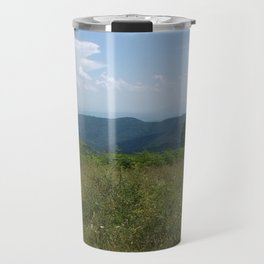 Meadow and mountains in the distance Travel Mug