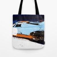 porsche Tote Bags featuring PORSCHE 917 -  by Michele Leonello
