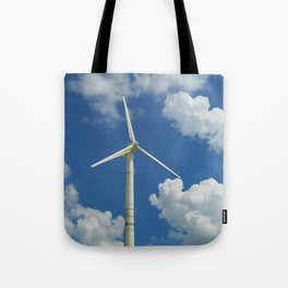 Wind Turbine Windmill in the Landscape with Yellow Colza Field and Blue Sky Tote Bag