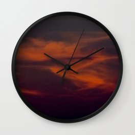 storm annoucement at sunset Wall Clock