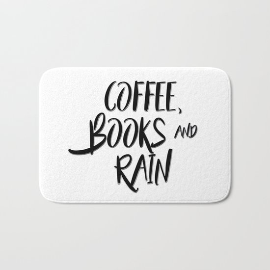 Coffee, books and rain quote Bath Mat