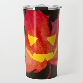 Jack-o-lantern face on Red Maple Leaf Travel Mug