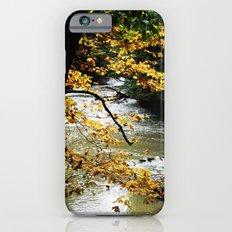 Runs through it. iPhone 6s Slim Case