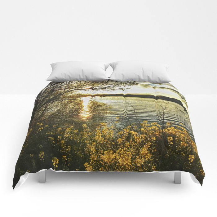 """Yellow flowers at sunset"" Comforters"