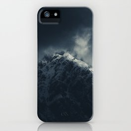 Darkness and storm clouds over mountains iPhone Case