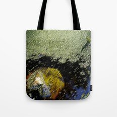 Yellow leaf in the water Tote Bag