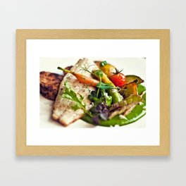 Branzino filet, chorizo dumplings, baby vegetables and spinach sauce Framed Art Print