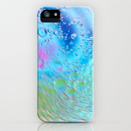 Oil drops in water in motion. Multicolored abstract defocused psychedelic pattern image with mooving boubbles . Abstract background with colorful gradient colors. DOF iPhone Case