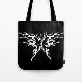 A tattoo with abstract flaming butterfly on the black background. Tote Bag