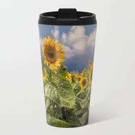 Blooming Sunflowers against a Cloudy Blue Sky Travel Mug