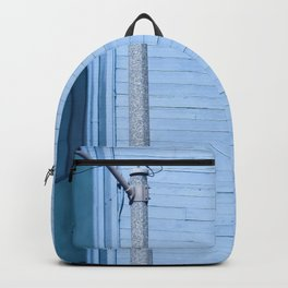 vintage blue wood building with window and electric pole Backpack