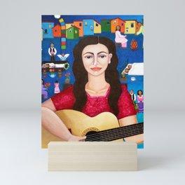 Violeta Parra playing guitar Mini Art Print