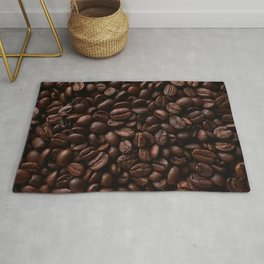 Dark roasted coffee beans arranged as flat background Rug