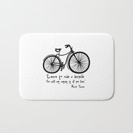 Learn to ride a bicycle. You will not regret it if you live. Bath Mat