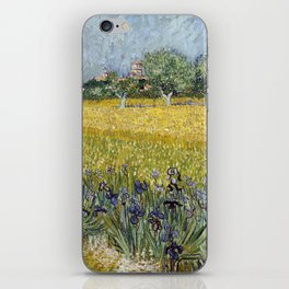 Field with flowers near Arles by Vincent van Gogh iPhone Skin