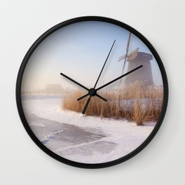 Dutch windmills in a foggy winter landscape in the morning Wall Clock