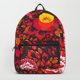 Valentine's Day card Heart made of red orange flowers on black background. Romantic invitation card Backpack