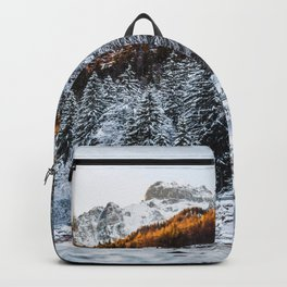 Autumn and winter river, forest and mountains Backpack