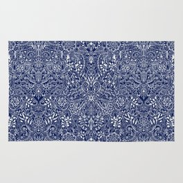 Detailed Floral Pattern in White on Navy Rug