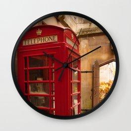 A tucked away booth Wall Clock