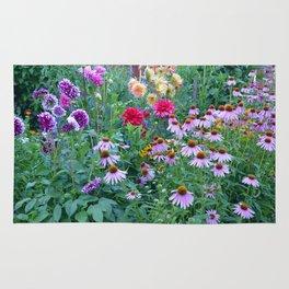 Dahlias and echinacea garden Rug