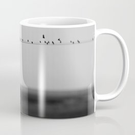 birds on wires in the still of the morning fog ... Coffee Mug