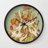 skulls Wall Clocks featuring skulls in spring by Teagan White