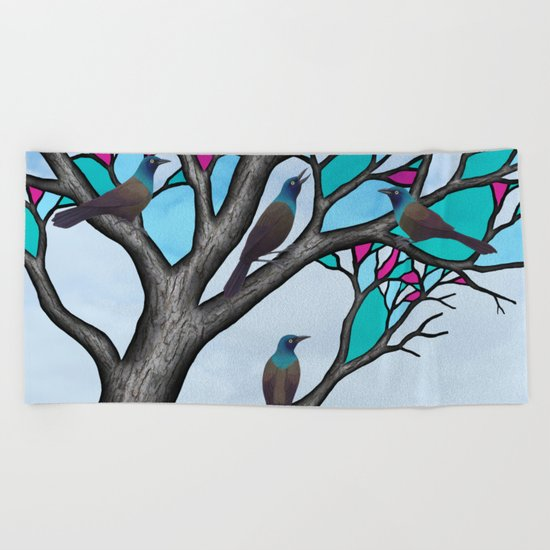 grackles in the stained glass tree Beach Towel